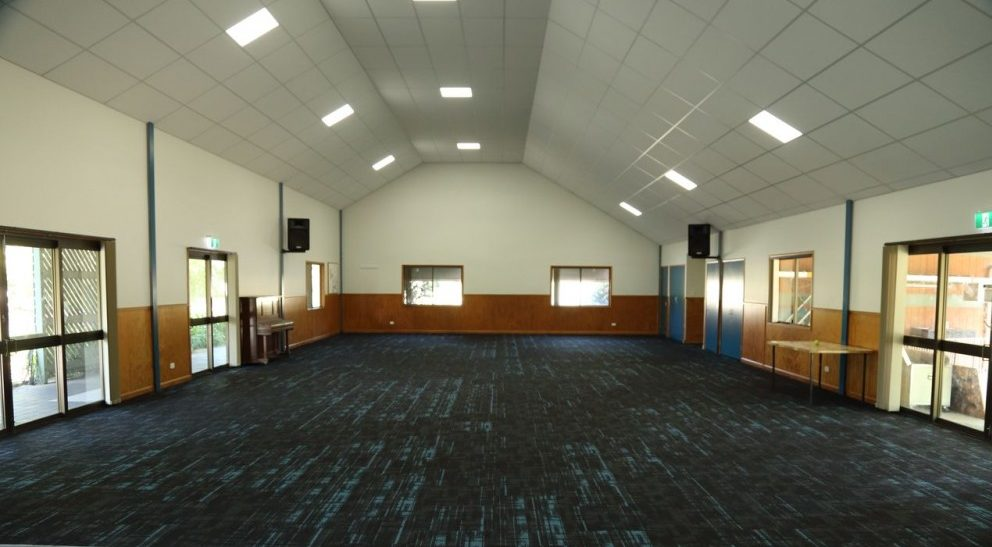 Church multipurpose after after installing new raked tile ceiling